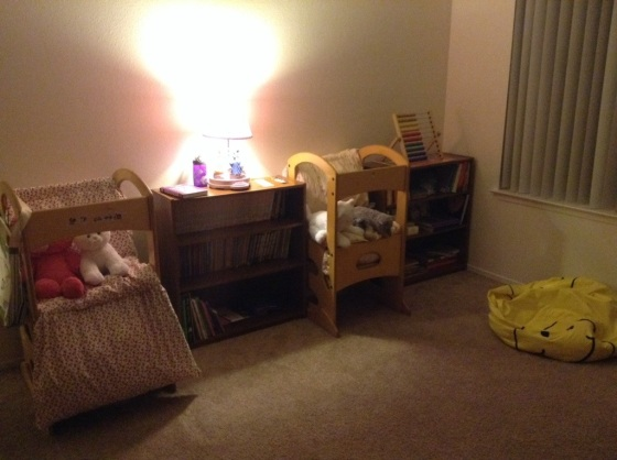 Reading Area - 2 bookcases, 2 learning towers, 2 pillow mats, and a menagerie of stuffed animals.